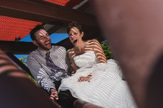 Bride and Groom laugh their asses off